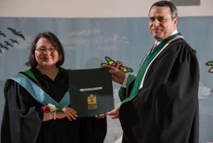 Maggie receiving diploma
